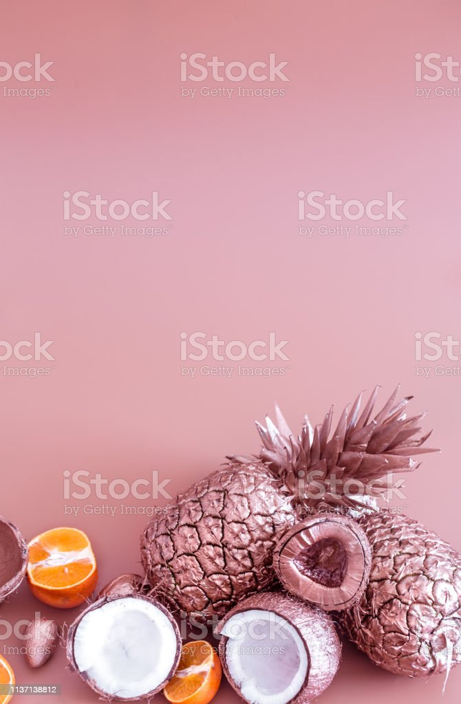 painted in gold fruit pineapple, coconut and tangerine on a colored...