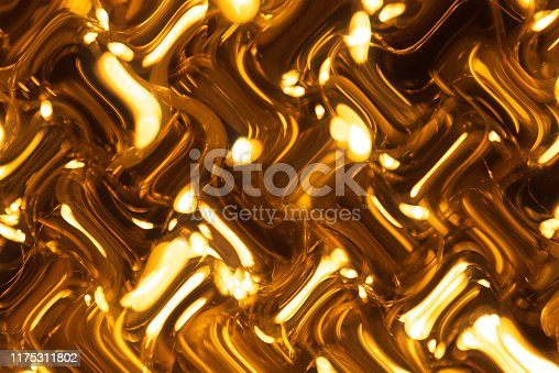 512401542istockphoto Gold colored glitter abstract 1175311802