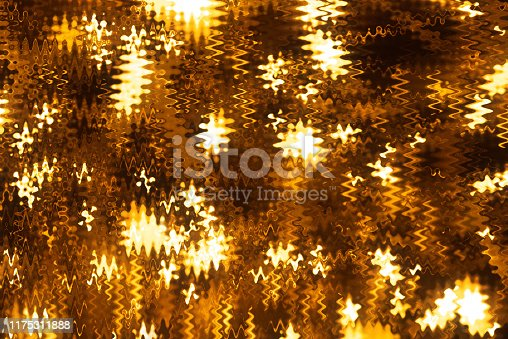 512401542istockphoto Gold colored glitter abstract 1175311888