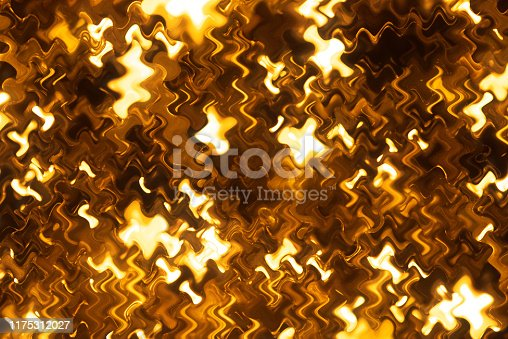 512401542istockphoto Gold colored glitter abstract 1175312027