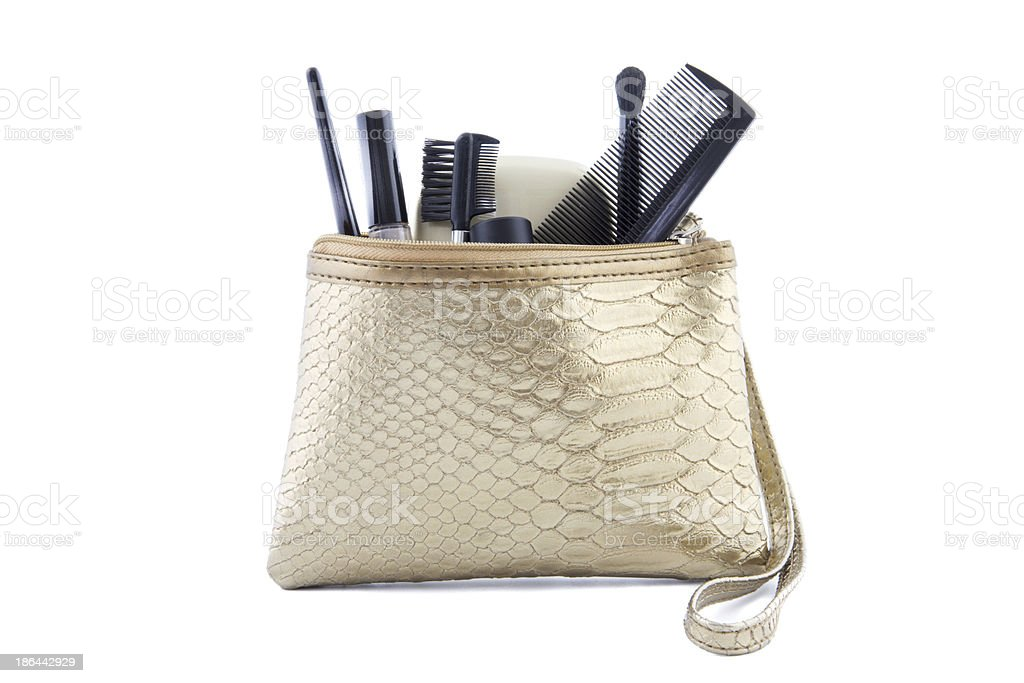 gold colored makeup bag with make-up stock photo