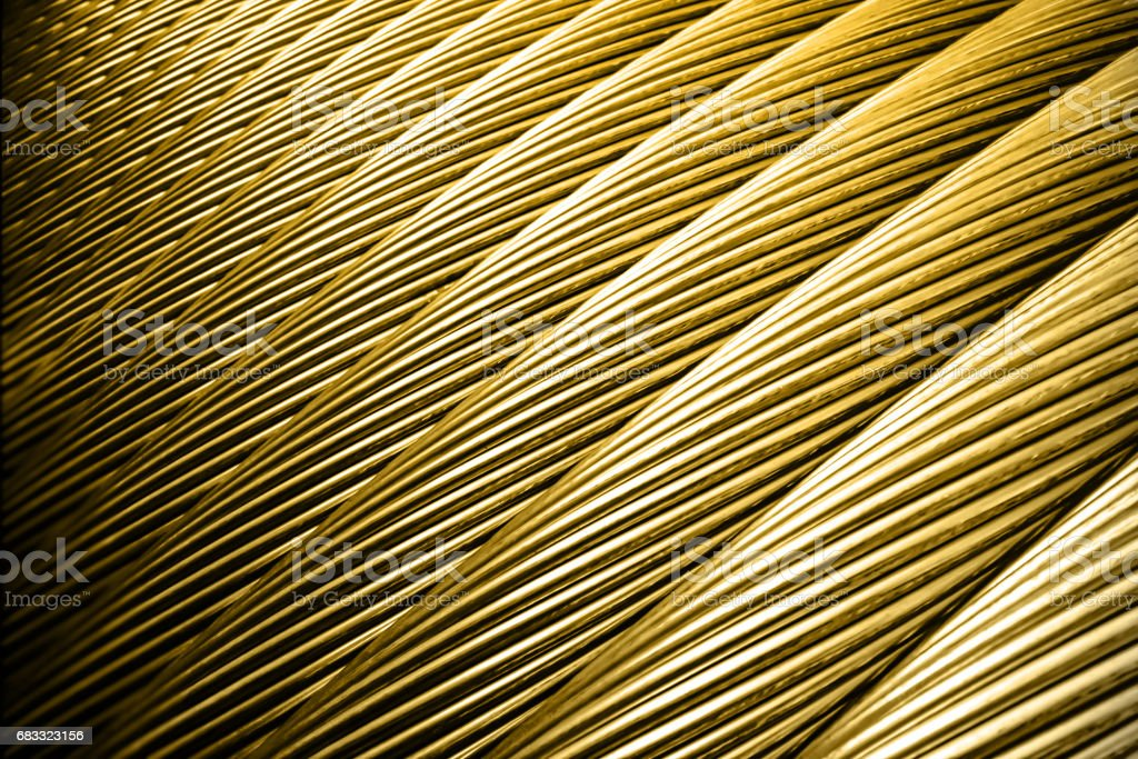 Gold colored steel rope close-up, background stock photo