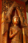 Gold Colored Wooden Sculpture in the Ancient Temple, Ayutthaya Historical Site, Thailand