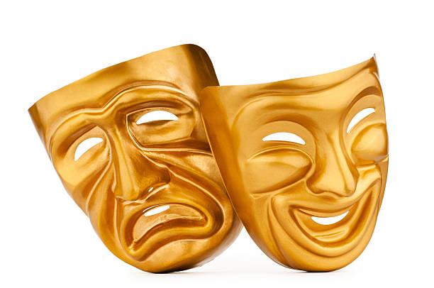 Gold comedy and tragedy masks stock photo