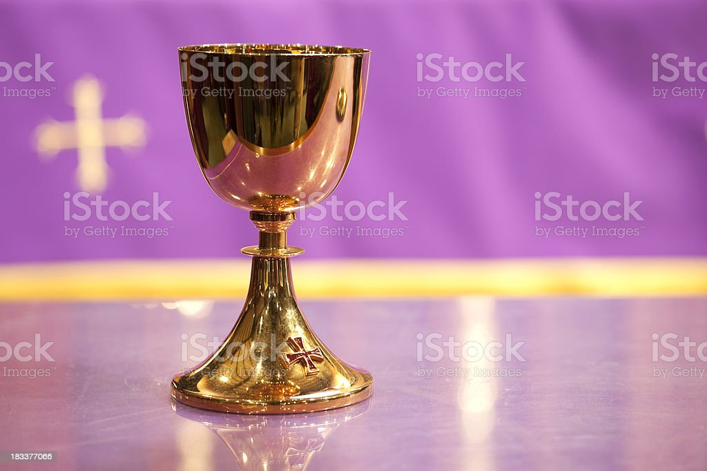 Gold Communion Chalice and Purple Background with Cross stock photo