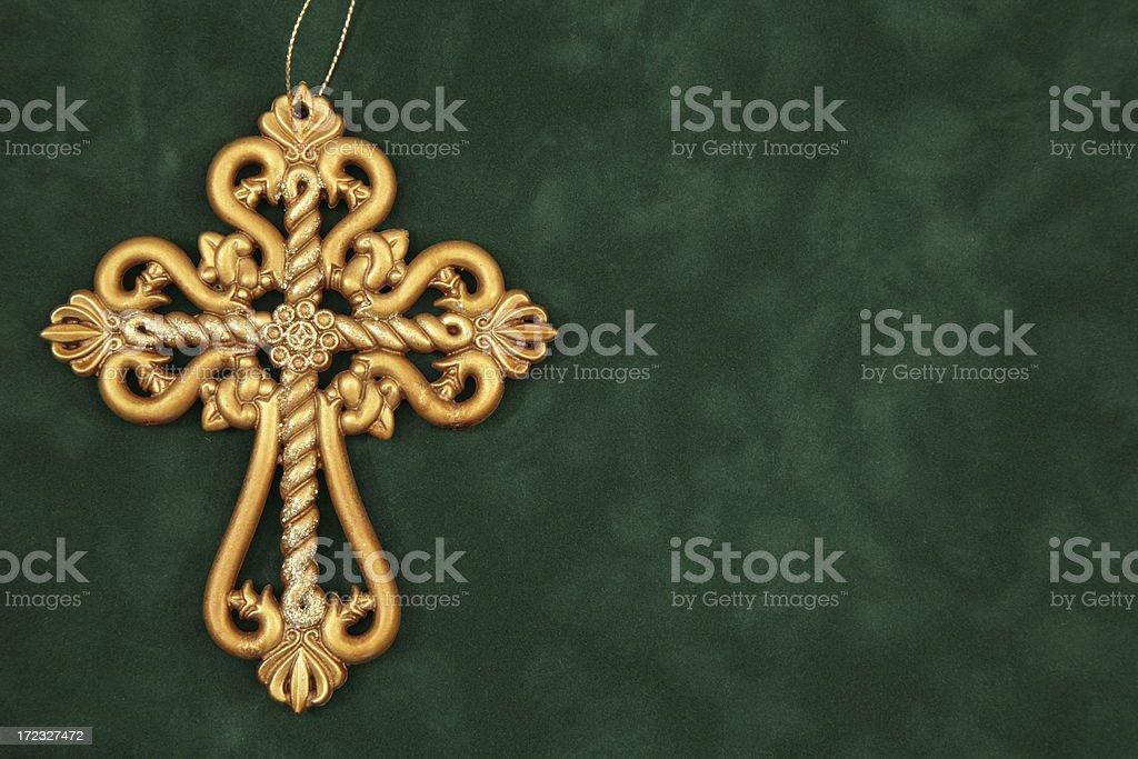 Gold Cross on Green stock photo
