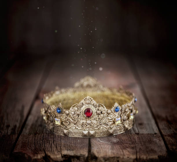 Gold Crown on an Old Wood Background stock photo
