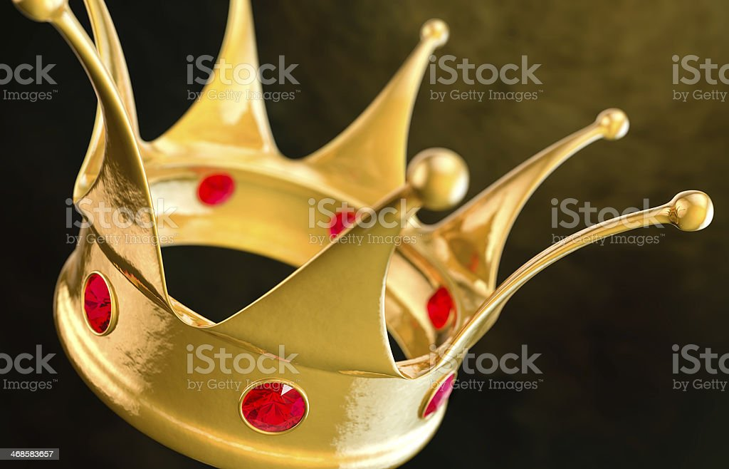 Gold crown with rubies on dark background royalty-free stock photo