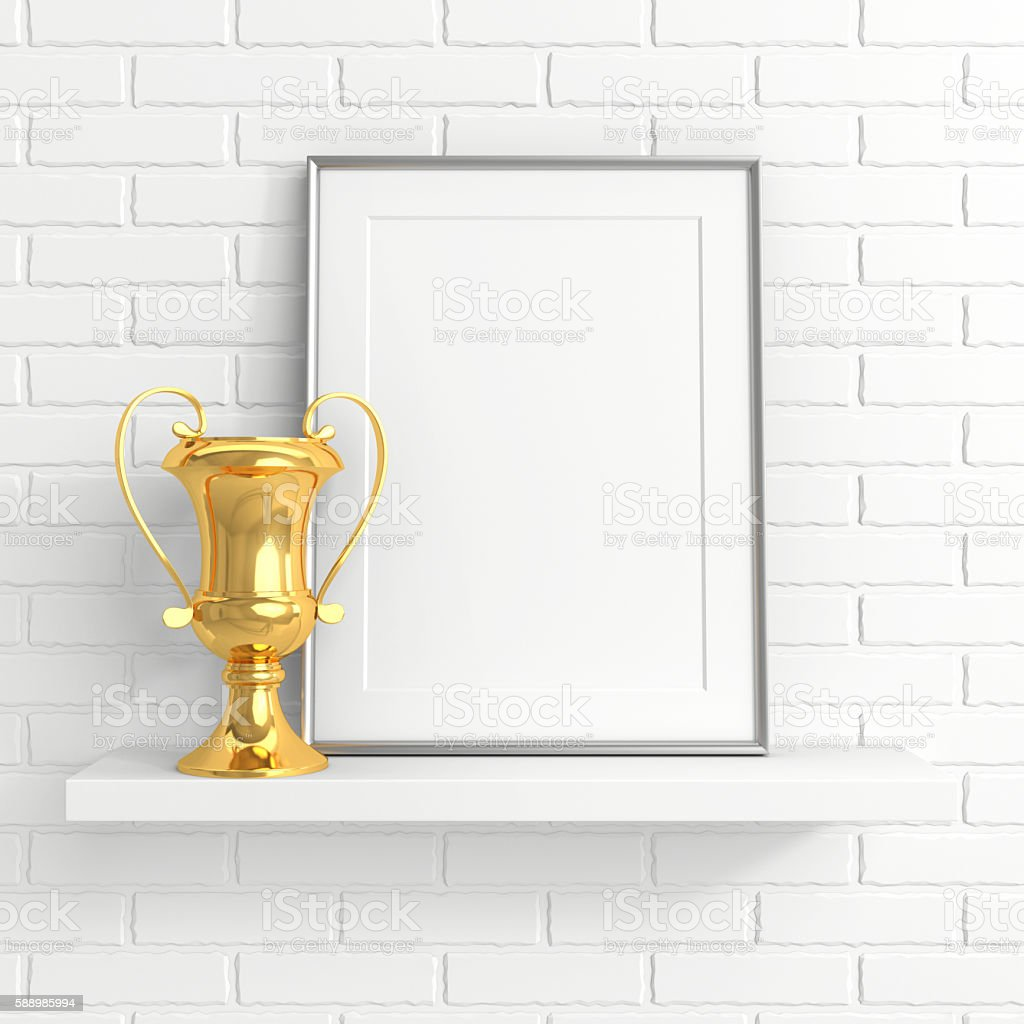 gold cup and blank photo frame on white shelf stock photo