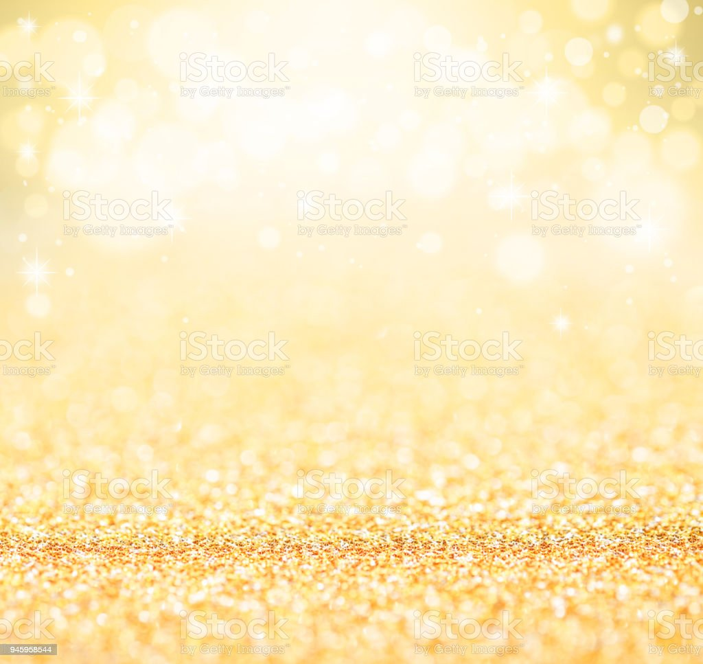 Gold defocused glitter background. stock photo