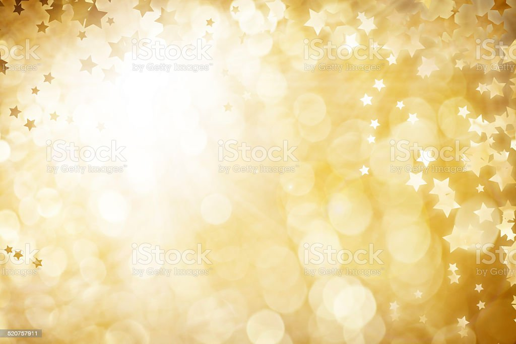 Gold Defocused Light Background For Christmas With Stars stock photo