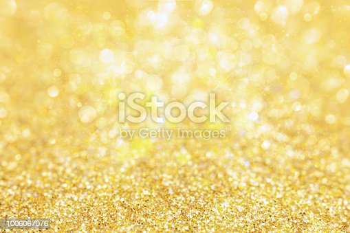 886746424 istock photo Gold Defocused Light For Christmas Background 1006067076