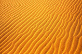 istock Gold desert into the sunset. Sand texture. 954073594