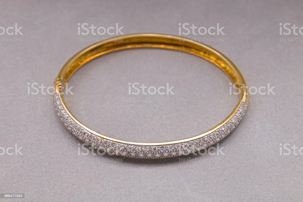 Gold Diamond Bracelet on Gray Background stock photo