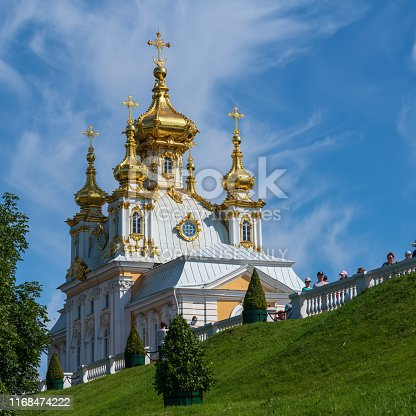 Petergof, Russia -- July 21, 2019. A photo of gold domed living quarters adjacent to the  Summer Palace in Petergof.
