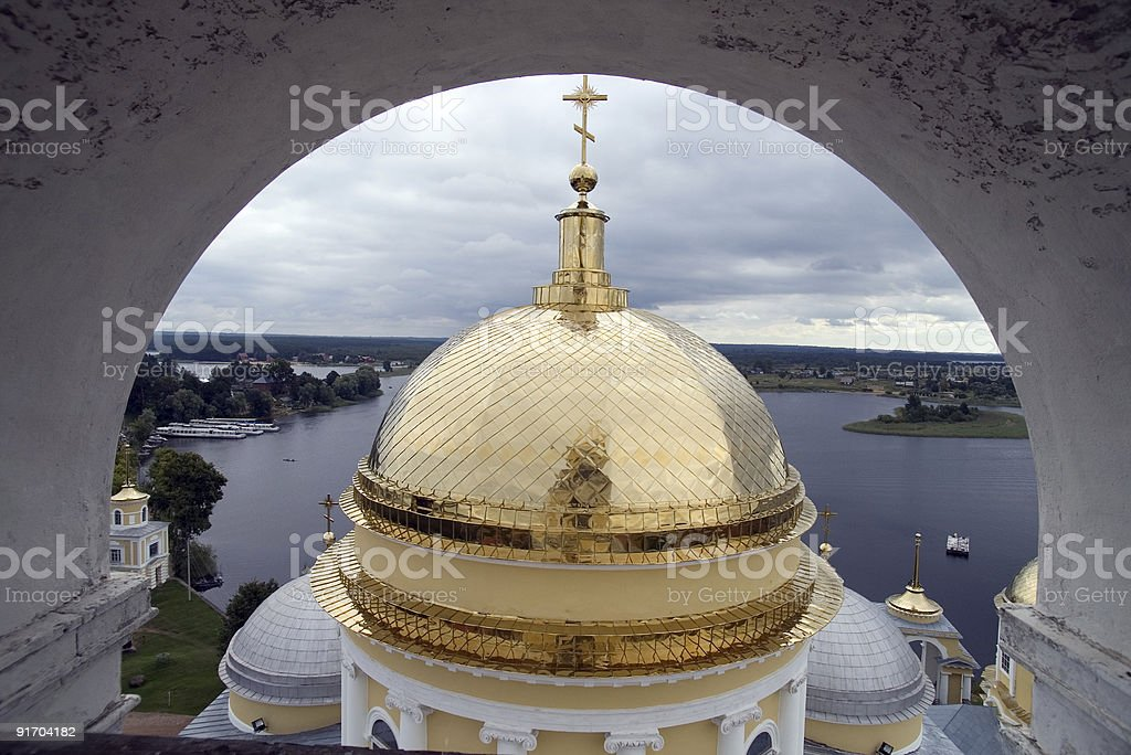 Gold domes of orthodox church with belltower's arch royalty-free stock photo