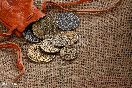 482747823istockphoto Gold Doubloons 486141216