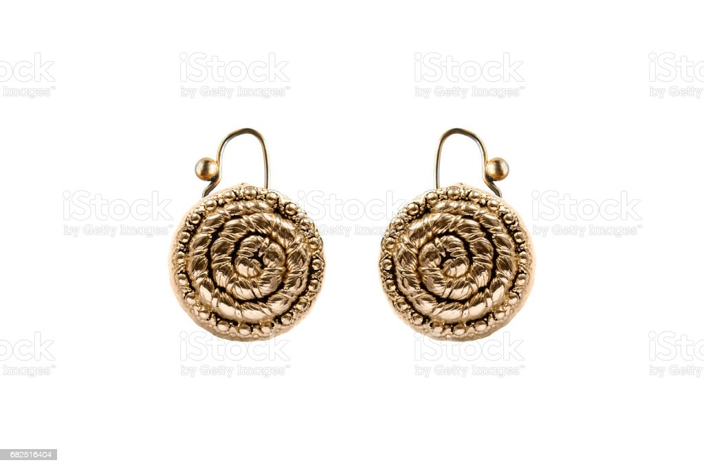 Gold earrings isolated royalty-free stock photo