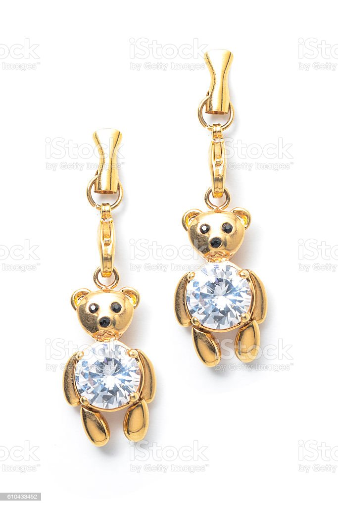 gold earrings teddy-bear stock photo