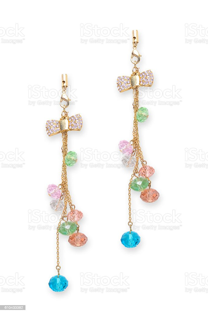 gold earrings with a bow and beads stock photo