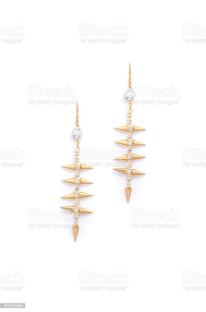 gold earrings with diamonds on a white background stock photo
