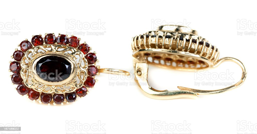gold earrings with ruby â royalty-free stock photo