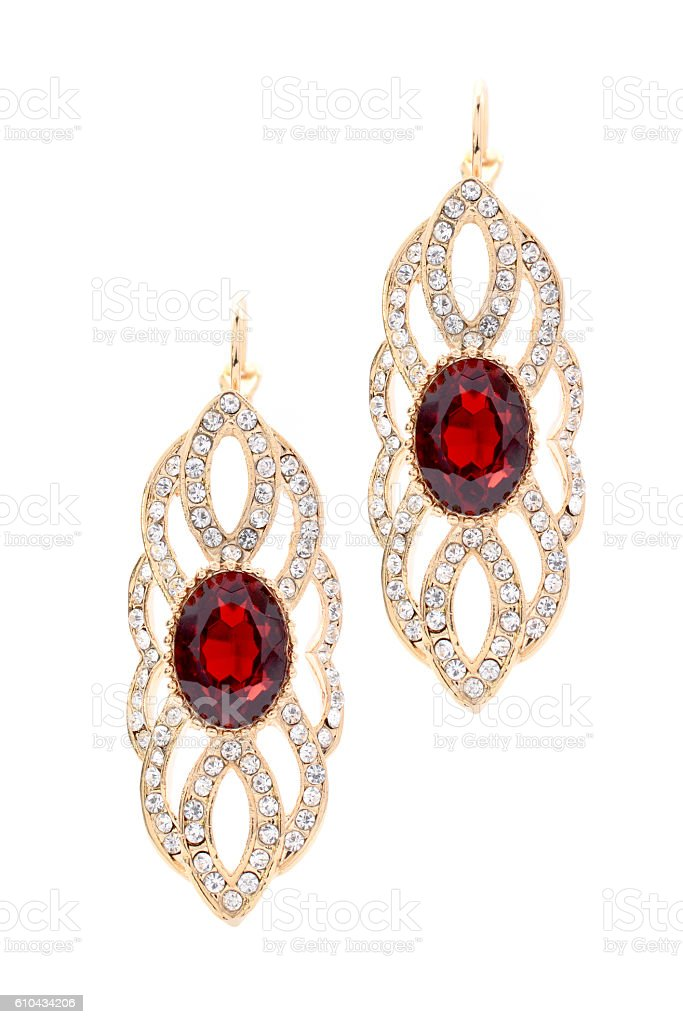 gold earrings with ruby stock photo