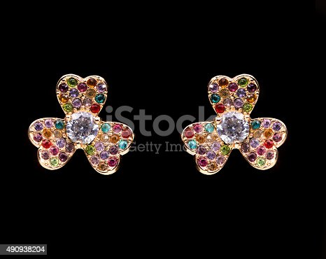 istock gold earrings with white little stones. in the form of 490938204