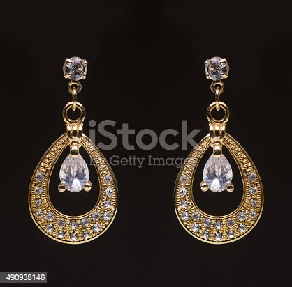 istock gold earrings with white little stones 490938146
