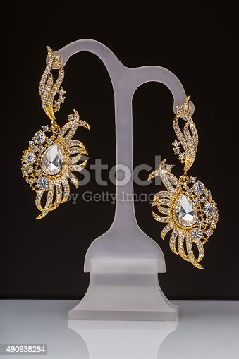 istock gold earrings with white little stones 490938264
