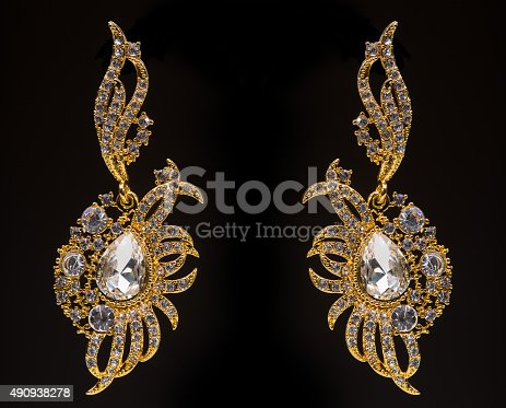 istock gold earrings with white little stones 490938278