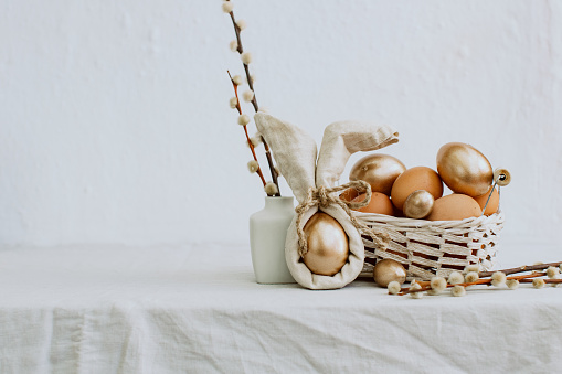 Gold Easter Eggs in Natural Linen Textile. Vintage style