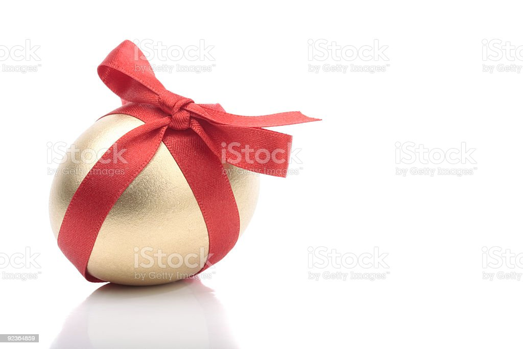 Gold egg with red ribbon royalty-free stock photo