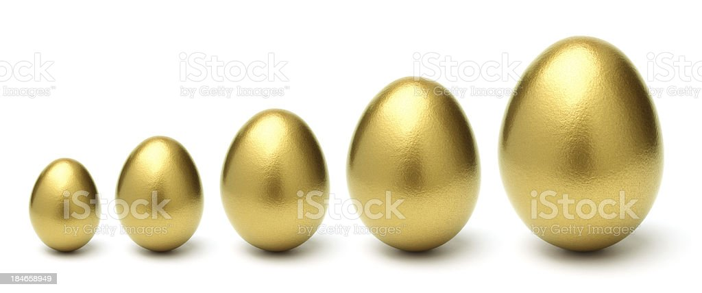 Gold Eggs Grow from Small to Large on White Background stock photo