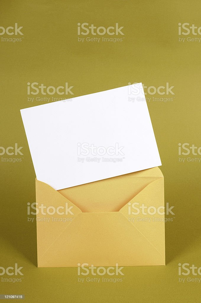 Gold envelope with blank message card royalty-free stock photo