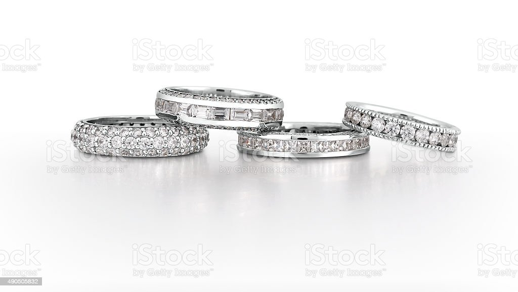 Gold Eternity Bands with diamonds stock photo