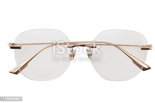 1047544590 istock photo Gold eyeglasses metal in round frame transparent for reading or good vision, top view isolated on white background 1133030607