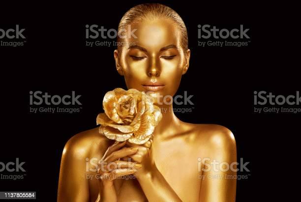 Gold fashion model beauty portrait with rose flower golden woman art picture id1137805584?b=1&k=6&m=1137805584&s=612x612&h=rh m0gjdfbudc4tbzbdjwxdmvyt stzi gybrc1 fdi=