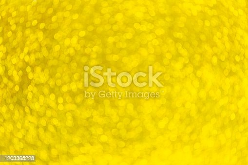 621116812 istock photo Gold Festive Christmas background. Elegant abstract background with bokeh defocused lights and stars 1203365228