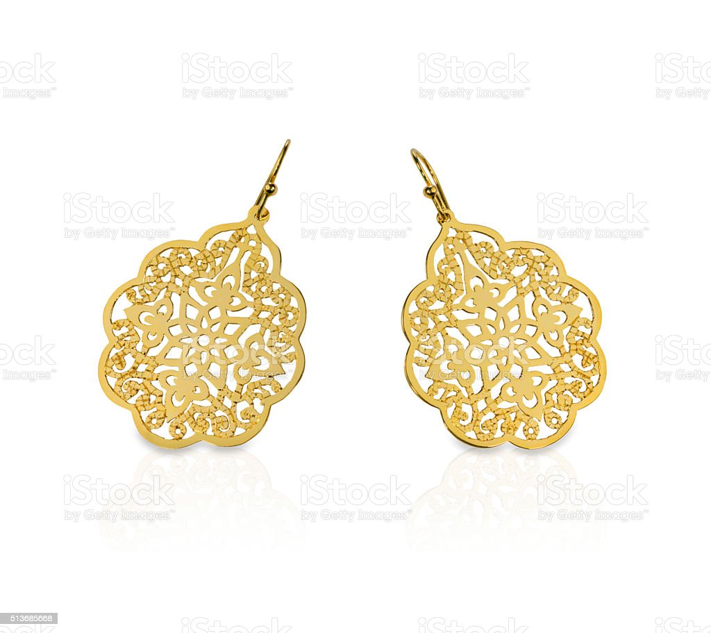 Gold filigree earrings stock photo