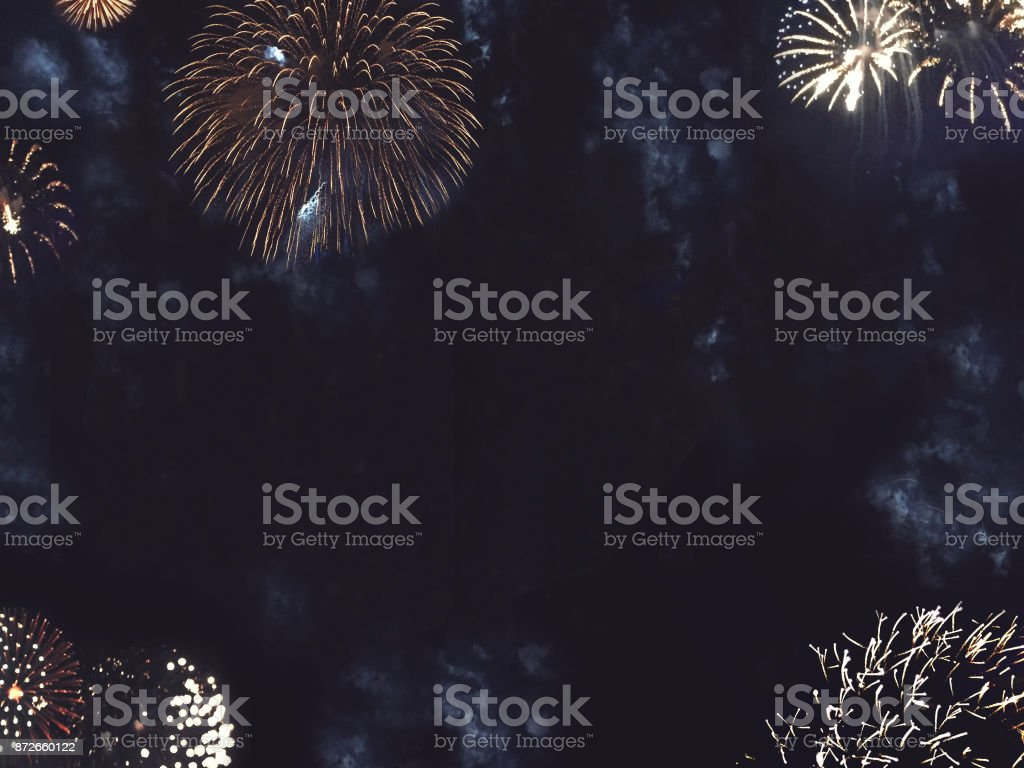 Gold Fireworks Border in Night Sky Festive Gold Fireworks Border in Night Sky for New Years and Independence Day Celebrations Anniversary Stock Photo