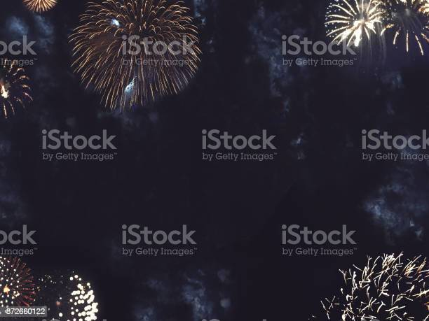Photo of Gold Fireworks Border in Night Sky