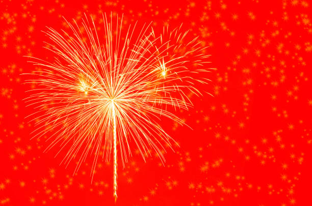 gold fireworks celebration on red background. - happy 4th of july zdjęcia i obrazy z banku zdjęć
