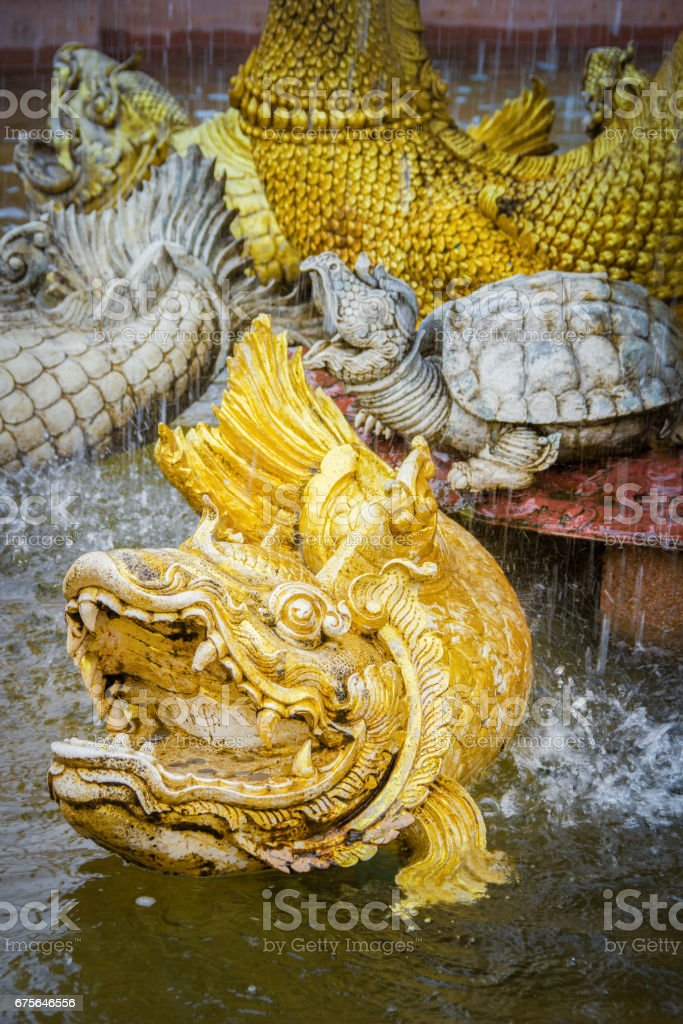 Gold fish statue in thai literature royalty-free stock photo