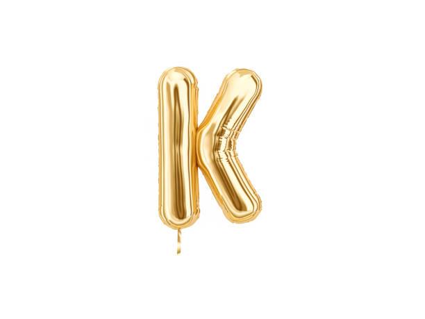 gold foil alphabet, letter k - буква k стоковые фото и изображения