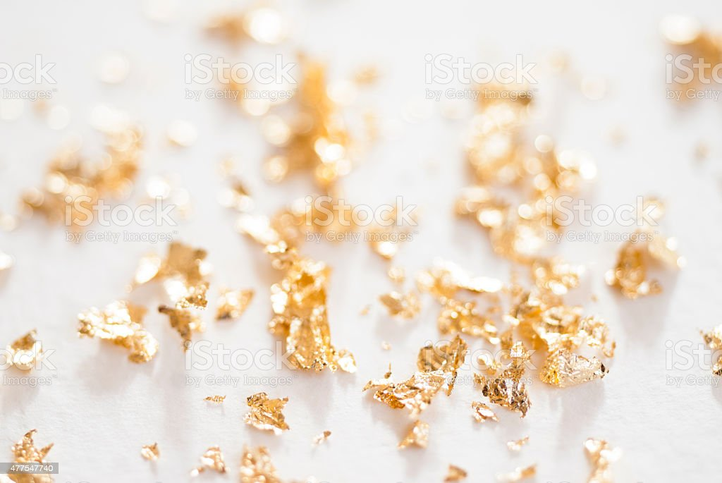 gold foil flakes stock photo