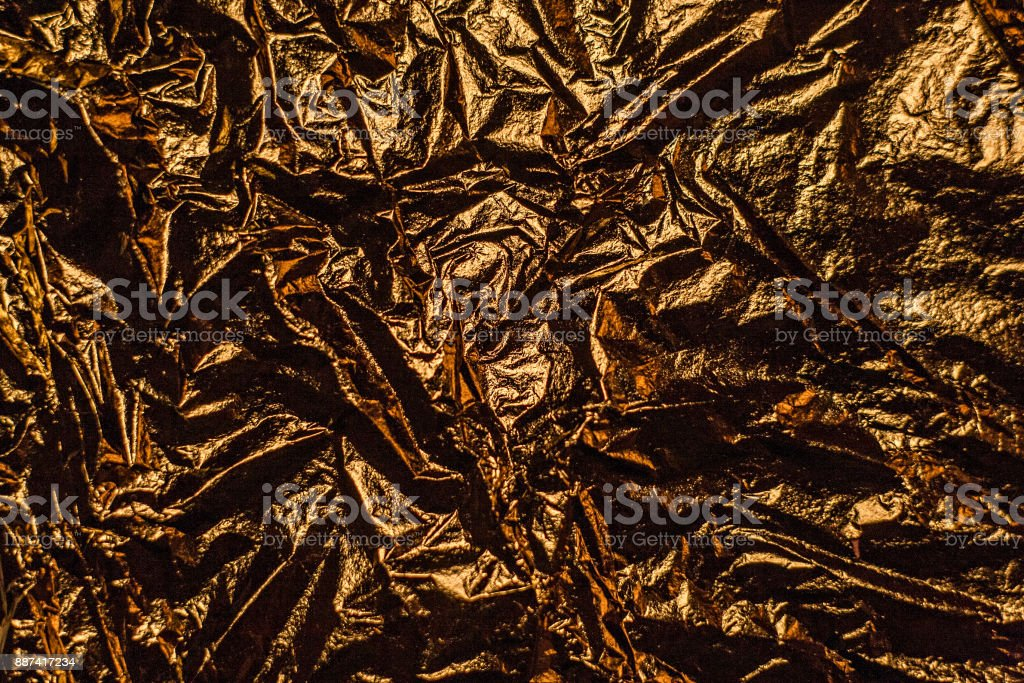 Gold foil leaf metallic wrapping paper shiny texture background for...