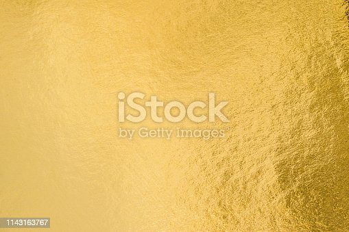 istock Gold foil leaf shiny wrapping paper texture background for wall paper decoration element 1143163767