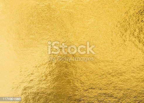 istock Gold foil leaf shiny wrapping paper texture background for wall paper decoration element 1174901583
