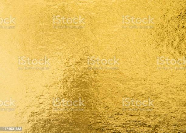 Photo of Gold foil leaf shiny wrapping paper texture background for wall paper decoration element